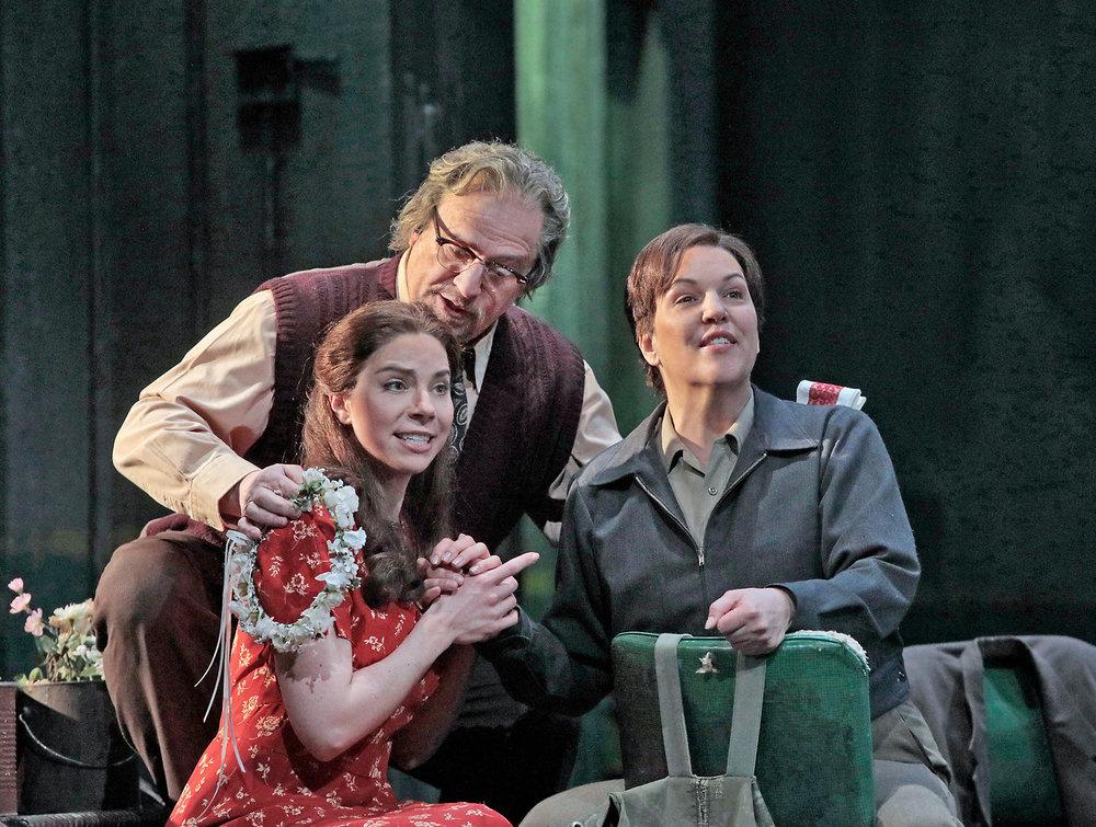 Hanna-Elizabeth Muller as Marzelline, Falk Struckmann as Rocco, and Adrianne Pieczonka as Leonore. Photo by Ken Howard; courtesy of the Metropolitan Opera.