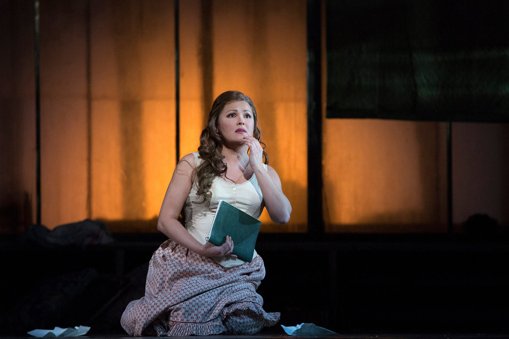 Anna Netrebko as a young Tatiana. Photo by Marty Sohl; courtesy of the Metropolitan Opera.