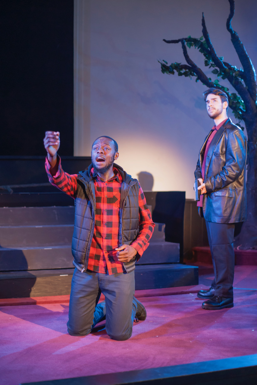A Gathering of Sons  - Victor protects his magic from the rogue cop, Lockdown. (l-r) Terriq White (Victor), Robert Gerold (Lockdown). Photos by Patti Brahim; courtesy of Pittsburgh Festival Opera.