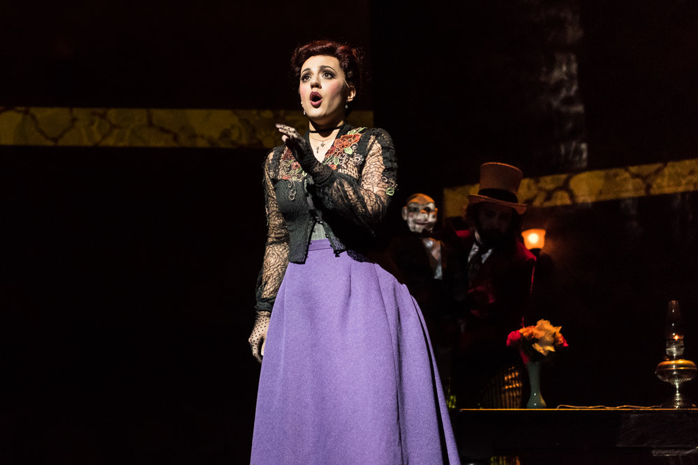 """Lambeth Marsh Lizzie"", aka Elizabeth Cree (Daniela Mack) tells how she came to be an orphan. Photo by Steve Pisano; courtesy of Opera Philadelphia."