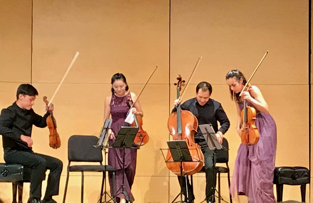 The Parker Quartet (Daniel Chong, Ying Xue, Kee-Hyun Kim, and Jessica Bodner) take their seats at the October 13, 2017 concert at St. John's College at Annapolis. Photo by Debra McCoy Rogers.