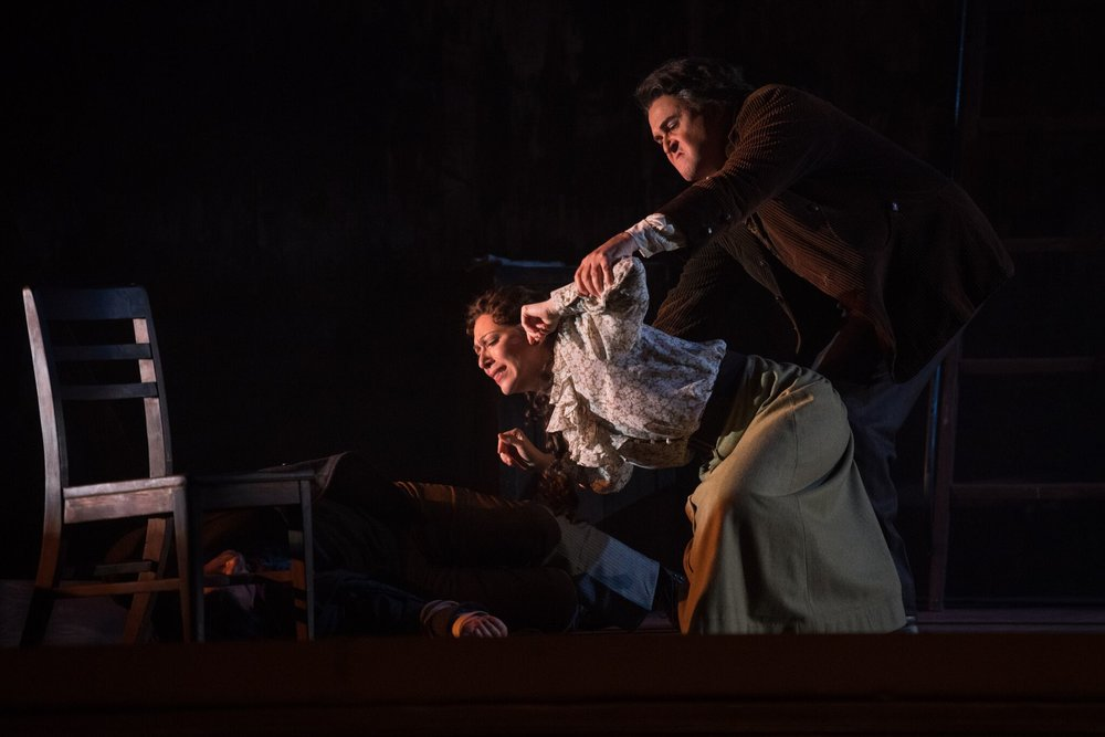 Michele (Grant Youngblood) forces Giorgetta (Eleni Calenos) to look at Luigi's corpse (Matthew Vickers). Photos by Moonloop Photography; courtesy of OperaDelaware.