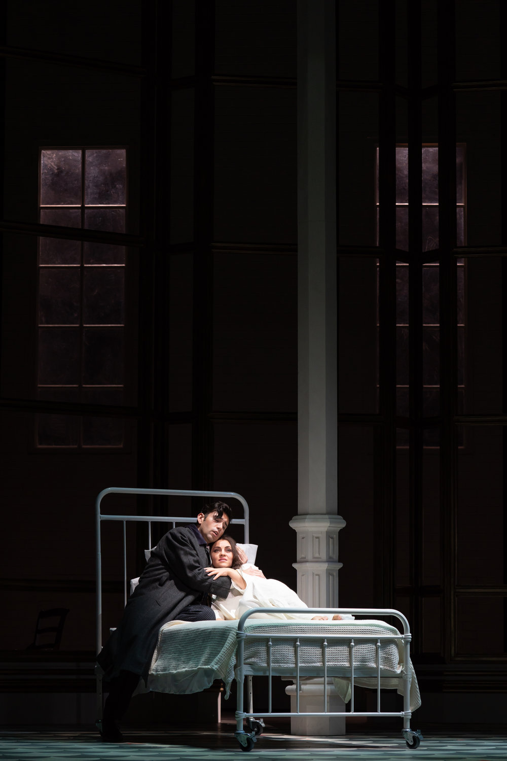 Alfredo (Joshua Guerrero) comforts Violetta (Venera Gimadieva) in her final moments. Photo by Scott Suchman; courtesy of the Washington National Opera.