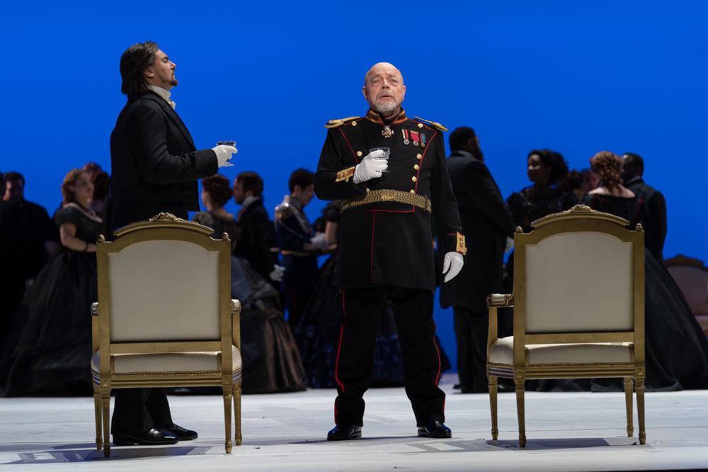 Prince Gremin (bass Eric Halfvarson) tells Onegin (baritone Igor Golovatenko) about his happy marriage in WNO's production of Eugene Onegin_credit Scott Suchman.JPG