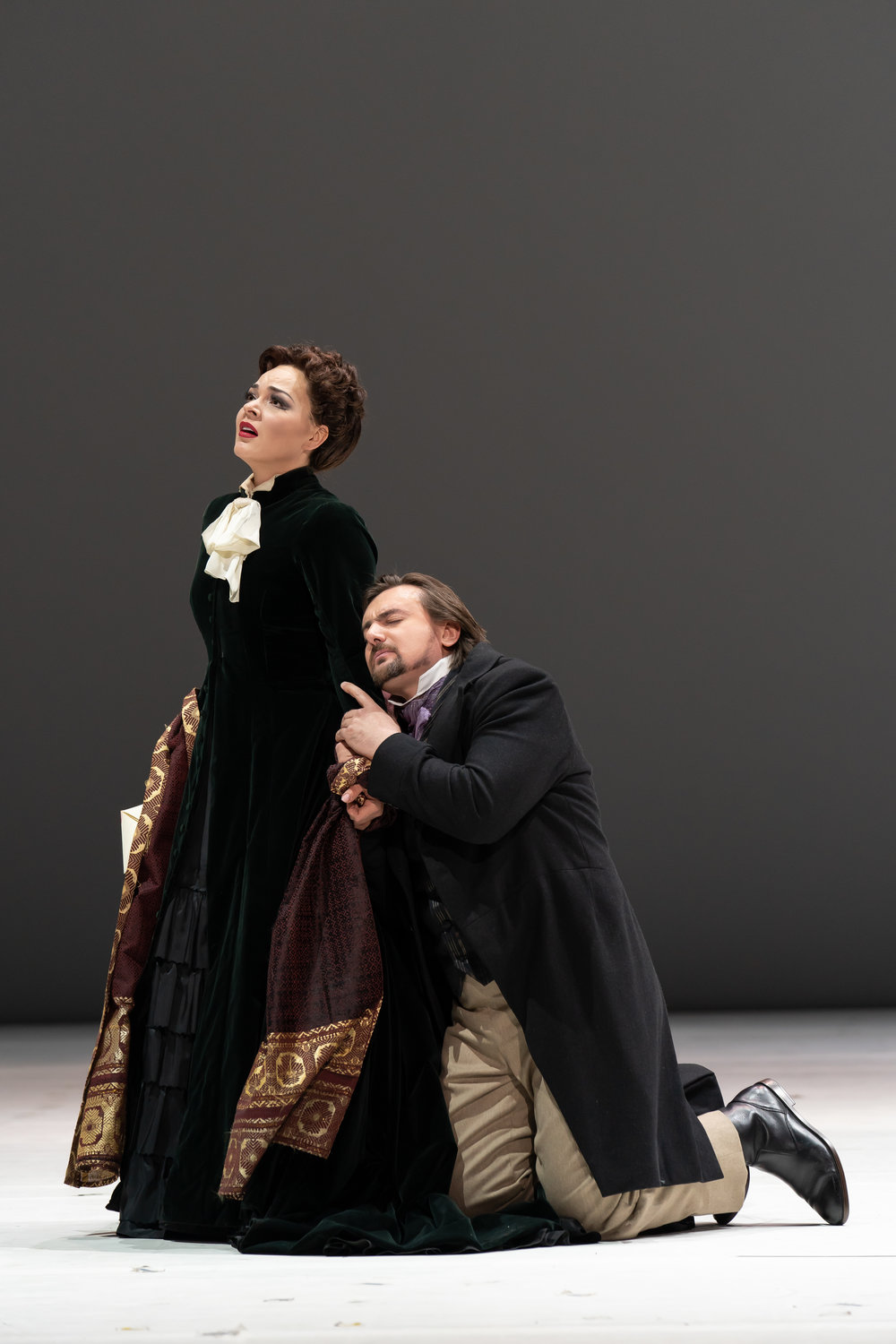 The closing scene of Eugene Onegin as Tatiana played by Anna Nechaeva refuses Onegin as played by Igor Golovatenko. Photo by Scott Suchman; courtesy of Washington National Opera.