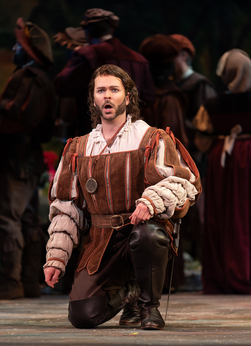 Valetin (baritone Joshua Hopkins), a young soldier, prepares for war and hopes God will protect his sister during his absence in WNO's production of Faust_credit Scott Suchman .jpg