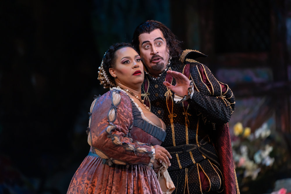 Mephistopheles (bass Raymond Aceto) predicts Marthe's (mezzo-soprano Deborah Nansteel) future in WNO's production of Faust_credit Scott Suchman.JPG