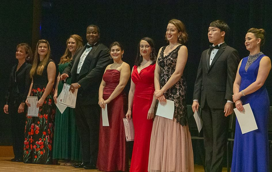 left to right : pianist Eileen Cornett; finalists: Anastasiia Sidorova, Dana McIntosh, Joshua Conyers, Rebecca Achtenberg, Mandy Brown, Kelsey Roberston, Min Kim Sang, and Rachel Blaustein. Photo by Mike Halbig; courtesy of Annapolis Opera.