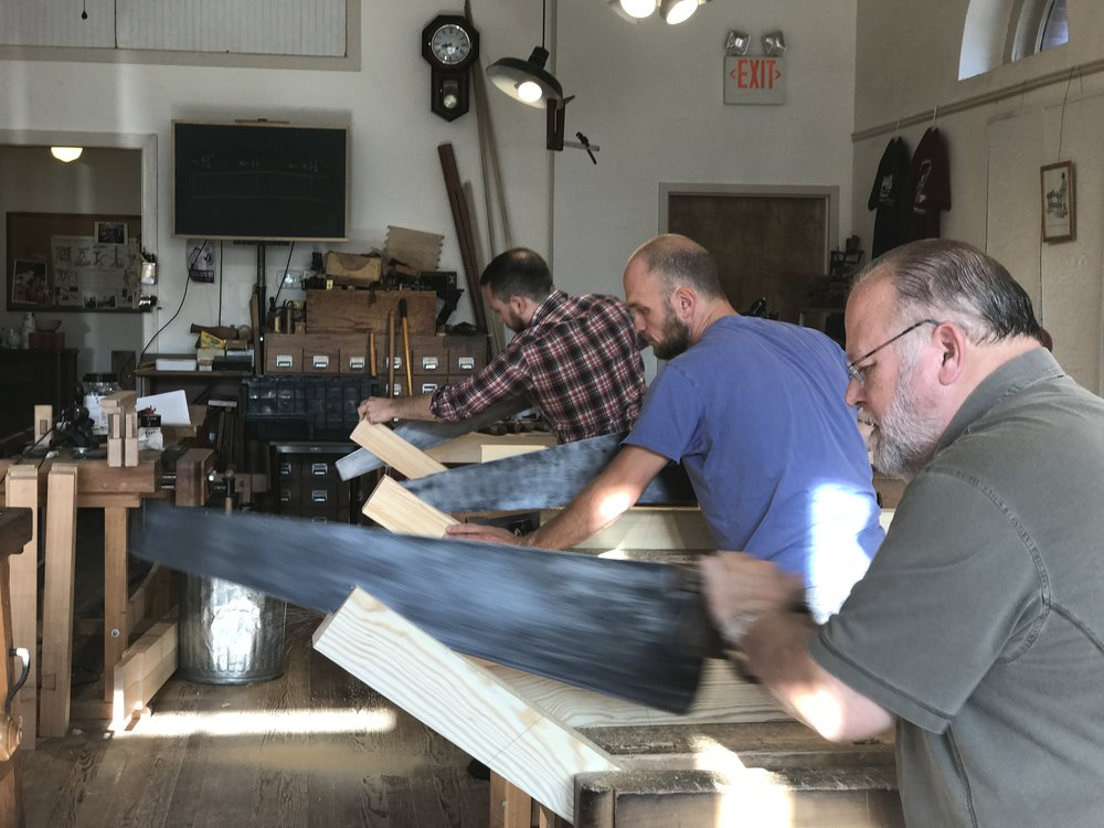 Here we are (I'm the one in the middle) cutting our angled tenons. This is around the moment when I fell in love with Will's 4 TPI rip saw which made fast work of these 10(ish) inch long tenons. Ed, upstairs, quickly found me something similar, sharpened it, and sold it to me. (Photo by Daniel Hamden).