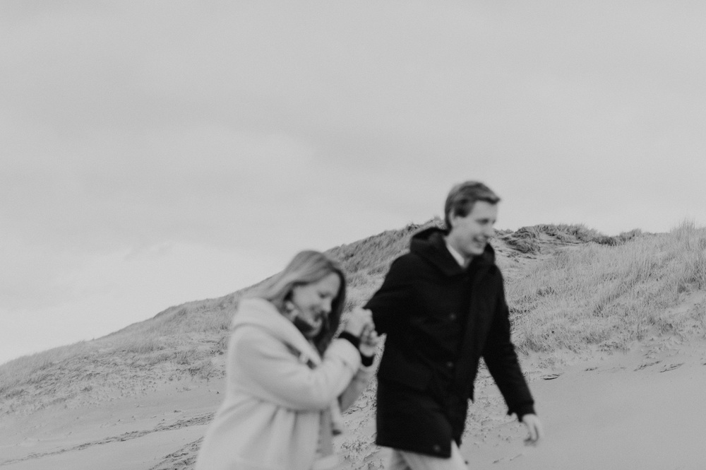 Couple walking on the beach of Bloemendaal