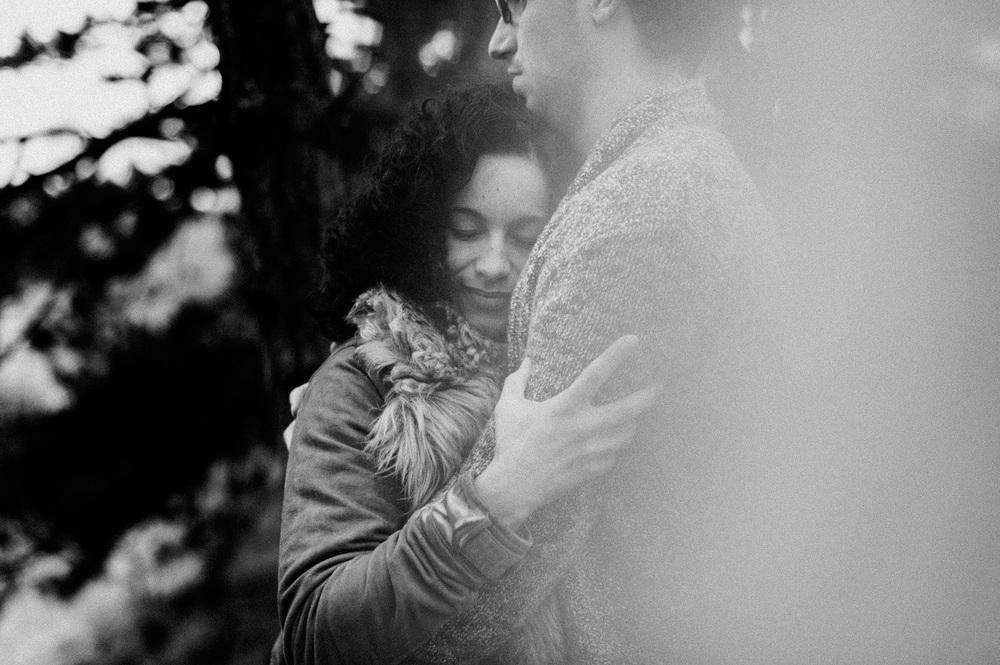 Girl holding her boyfriend in forrest