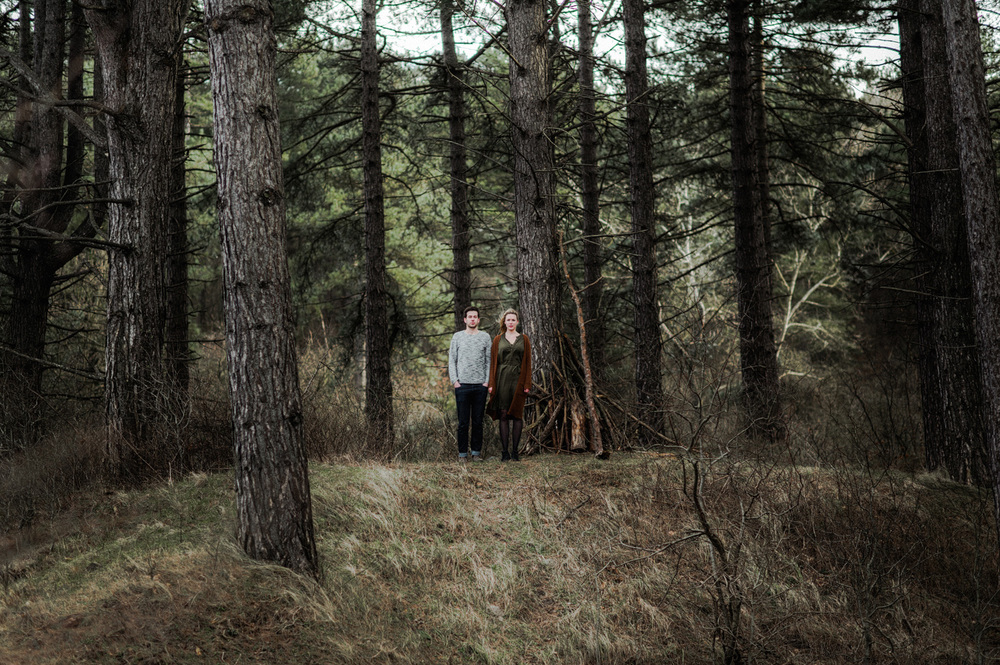 Couple far away in the forrest
