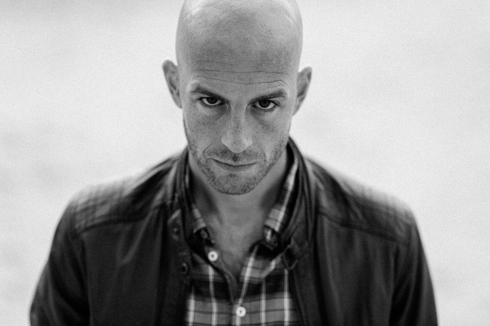Close up portrait of bald guy