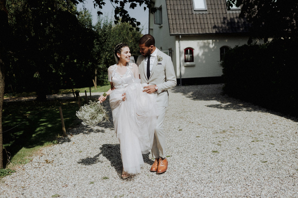 Bride and groom smiling together at in de Kas, Winssen