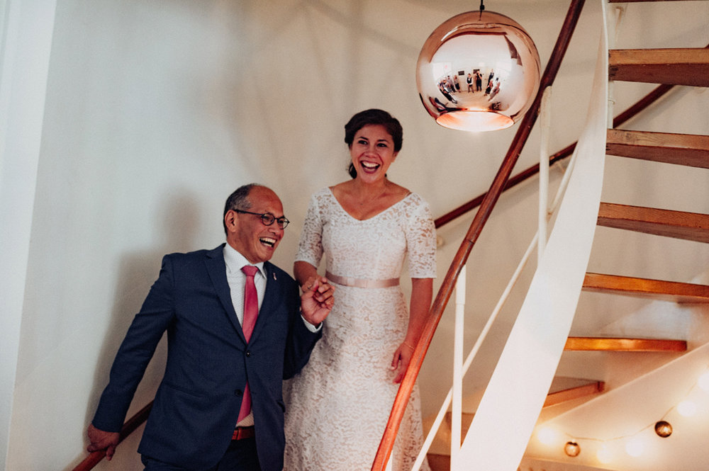 Bride coming down the stairs with her father