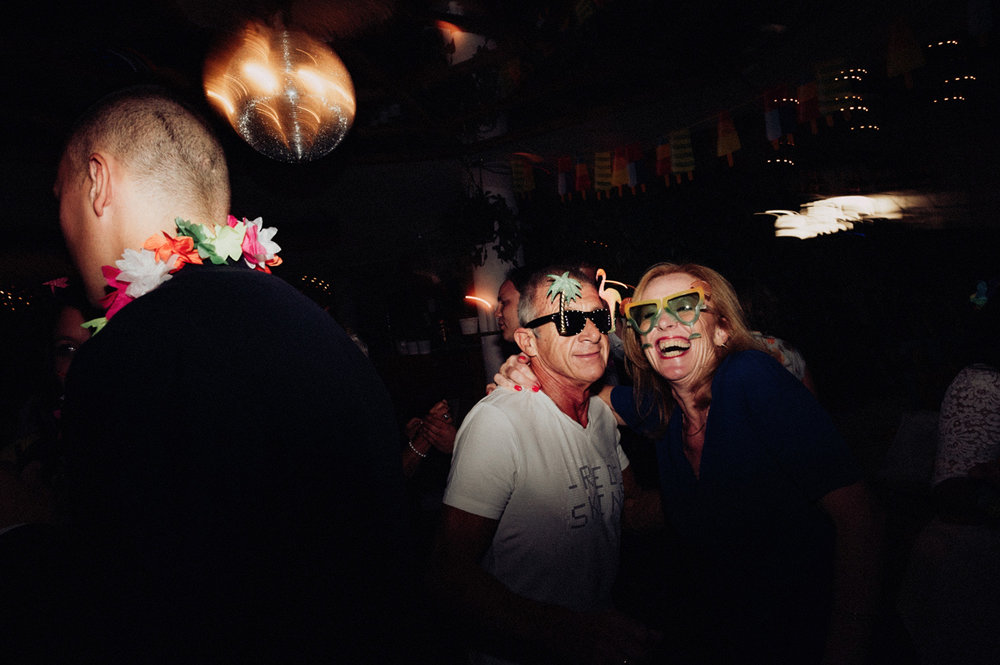 People at party wearing party outfit and funny glasses
