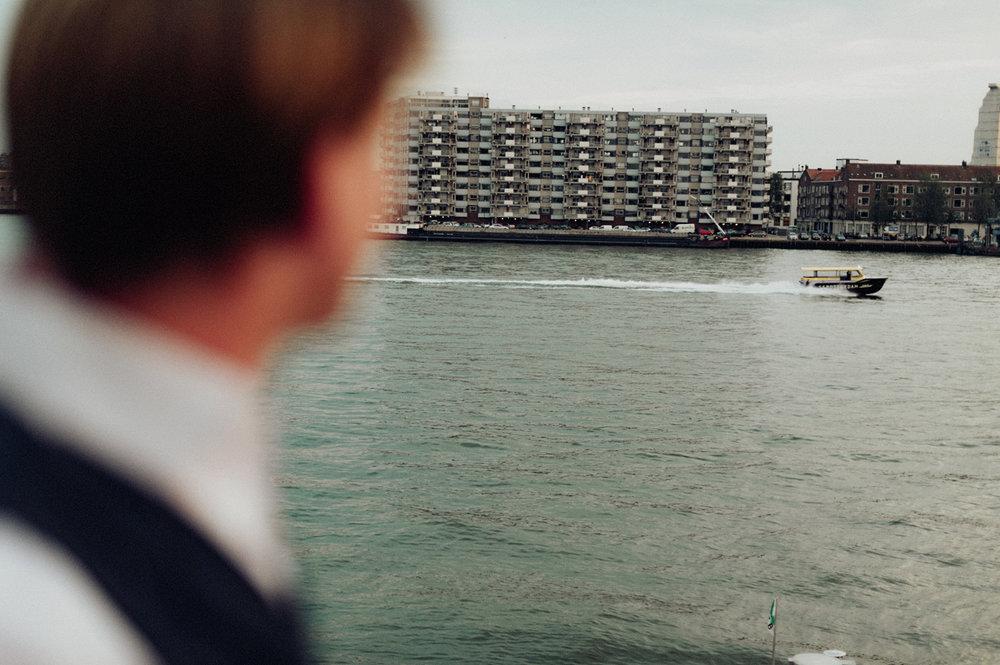 Groom watching water taxi, Maas Rotterdam