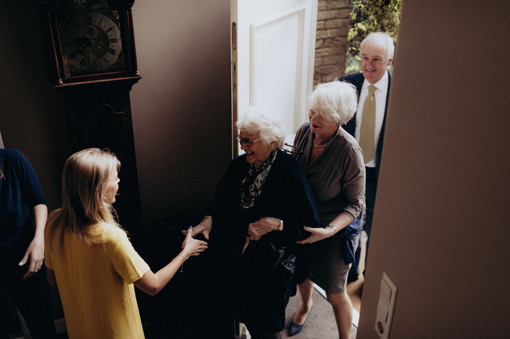 Grandmother of bride arriving at parents house