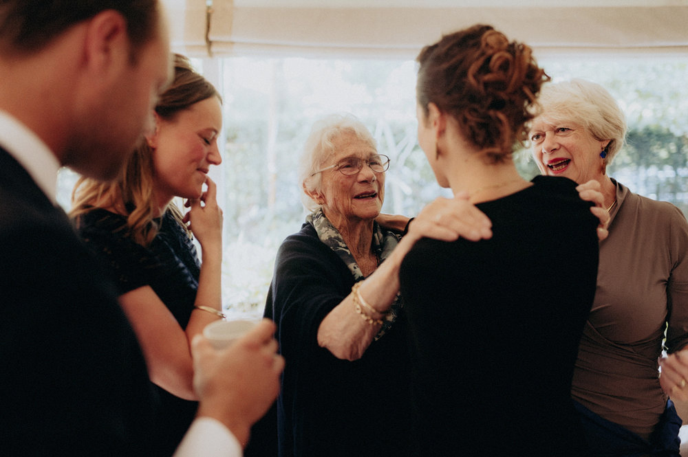 Grandmother of bride hugging people