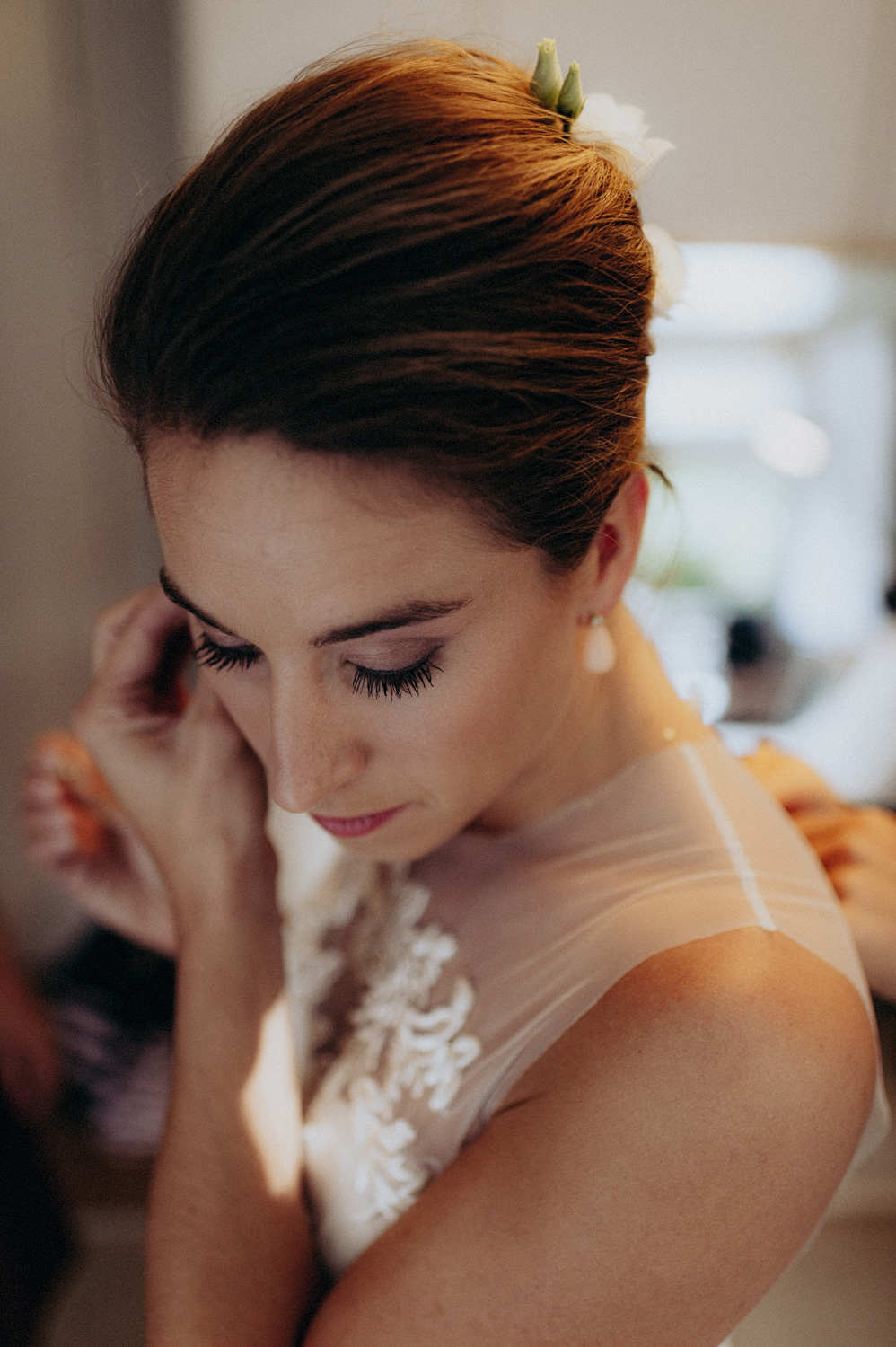 Portrait of bride putting in her wedding earrings