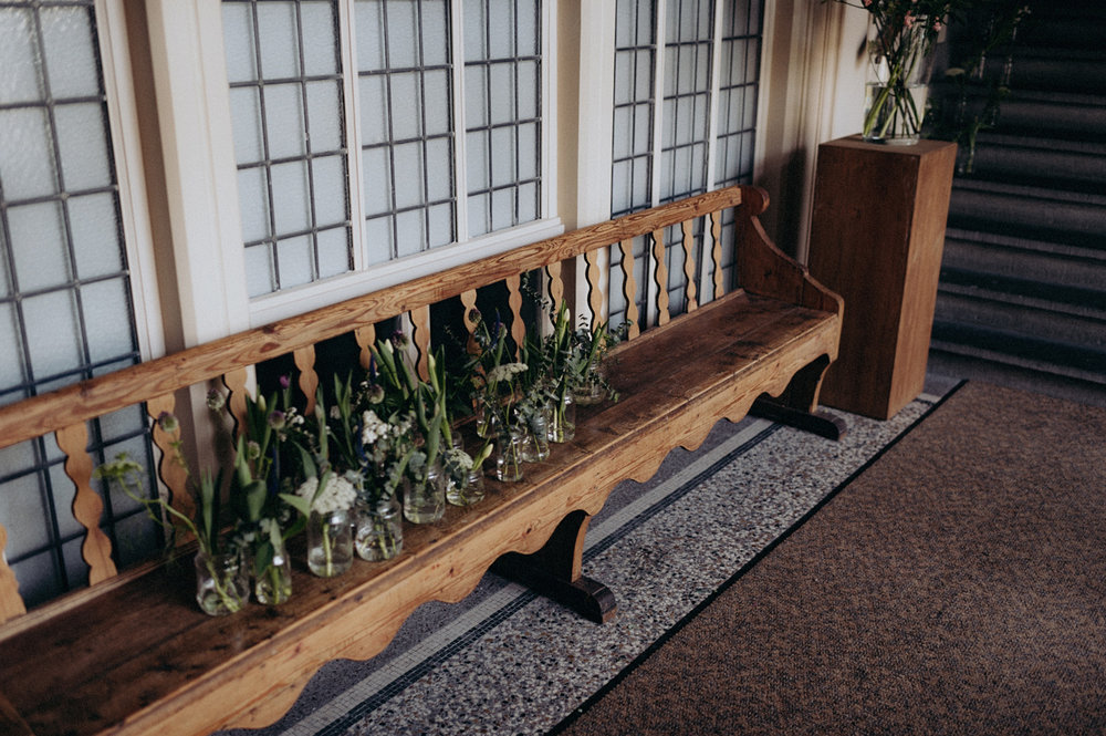 Church bench with wedding flowers