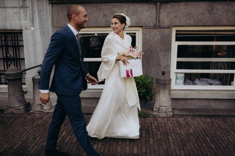 Bride and groom walking in Amsterdam