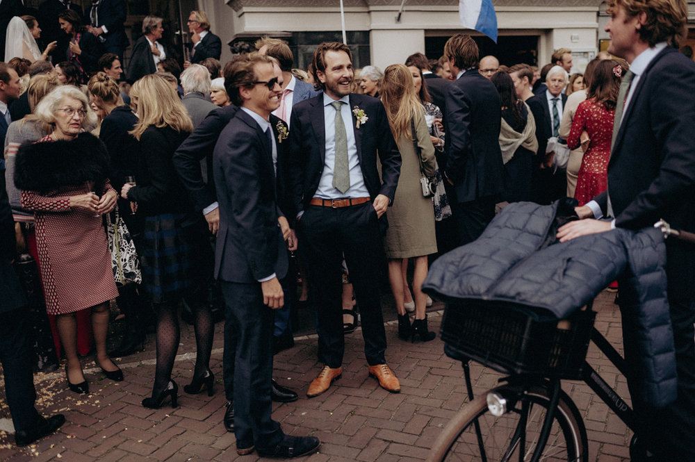 Wedding guests on the streets of Amsterdam