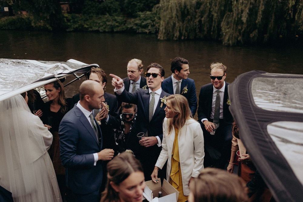 Wedding guests in boat at canals of Amsterdam