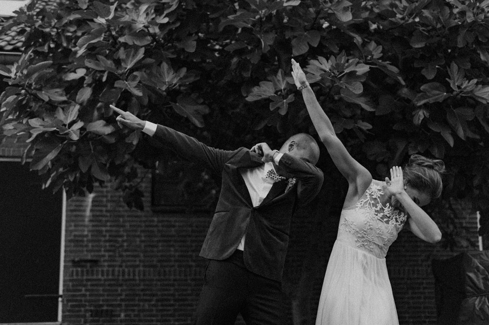 Bride and groom dabbing at Rijk van de Keizer