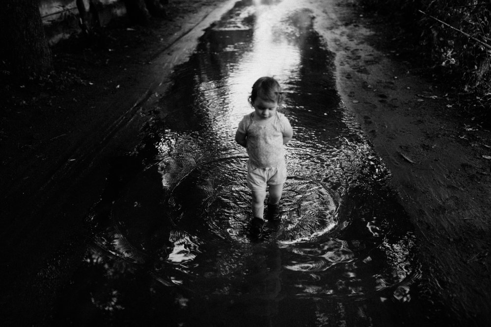 Kid walking through water