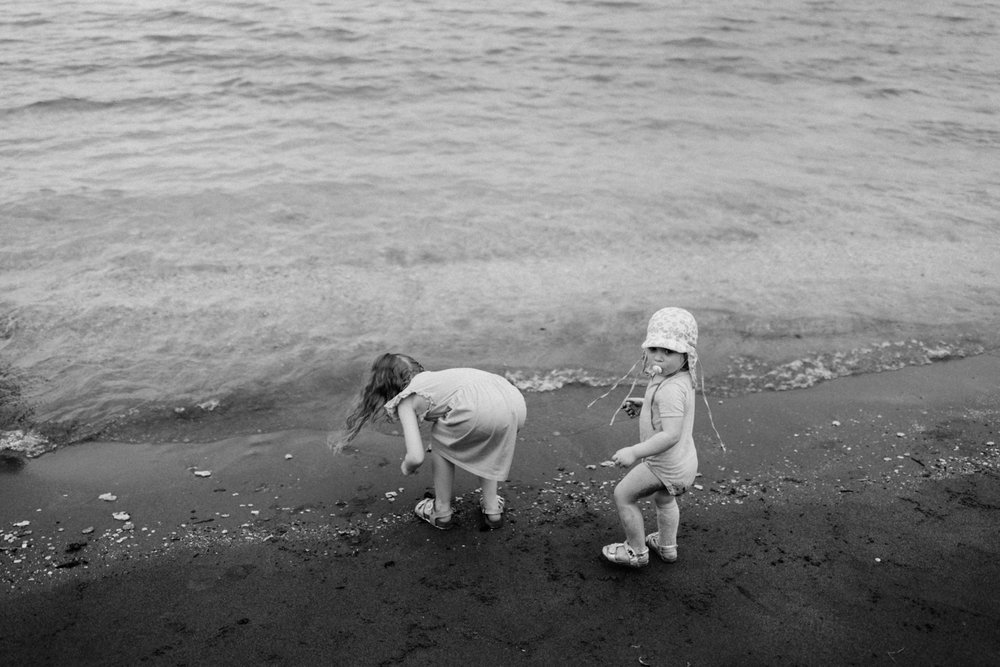 Kids looking for seashells at the beach