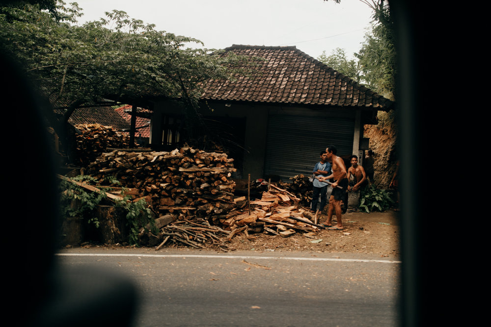 Man chopping wood in Bali, Indonesia