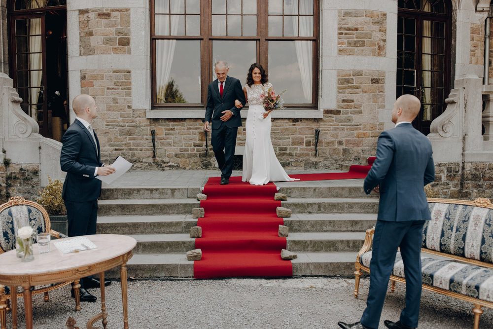 Bride arriving at ceremony in Chateau de Presseux