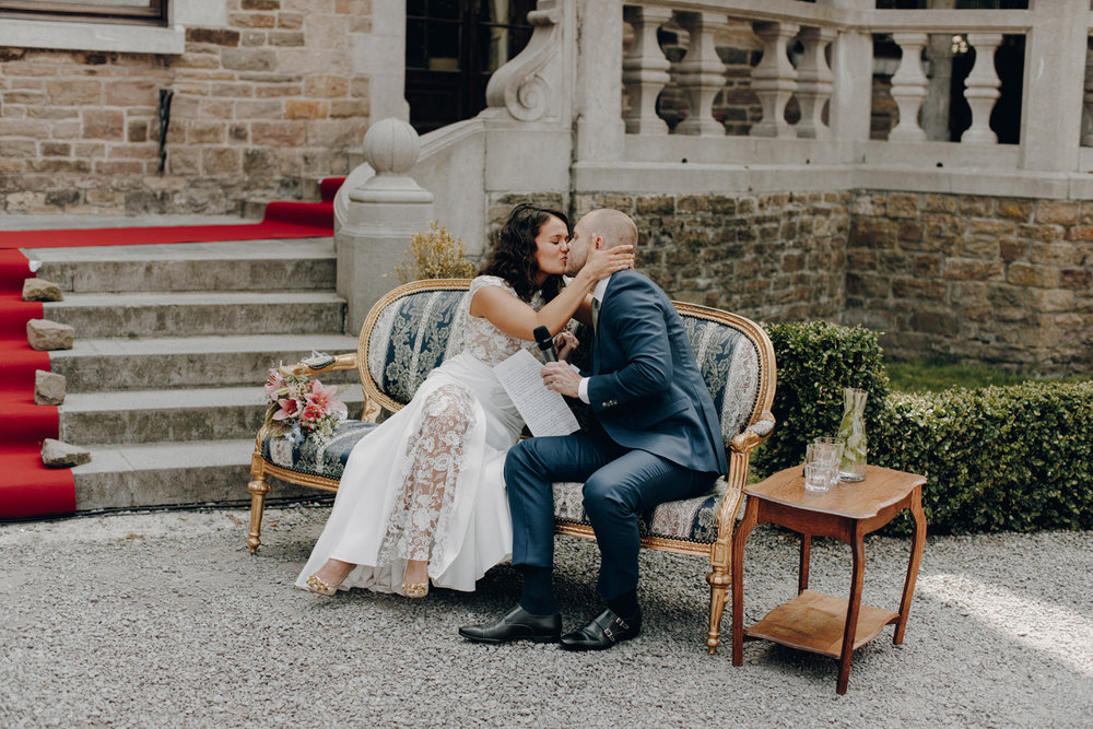Bride and Groom kissing at Chateau de Presseux