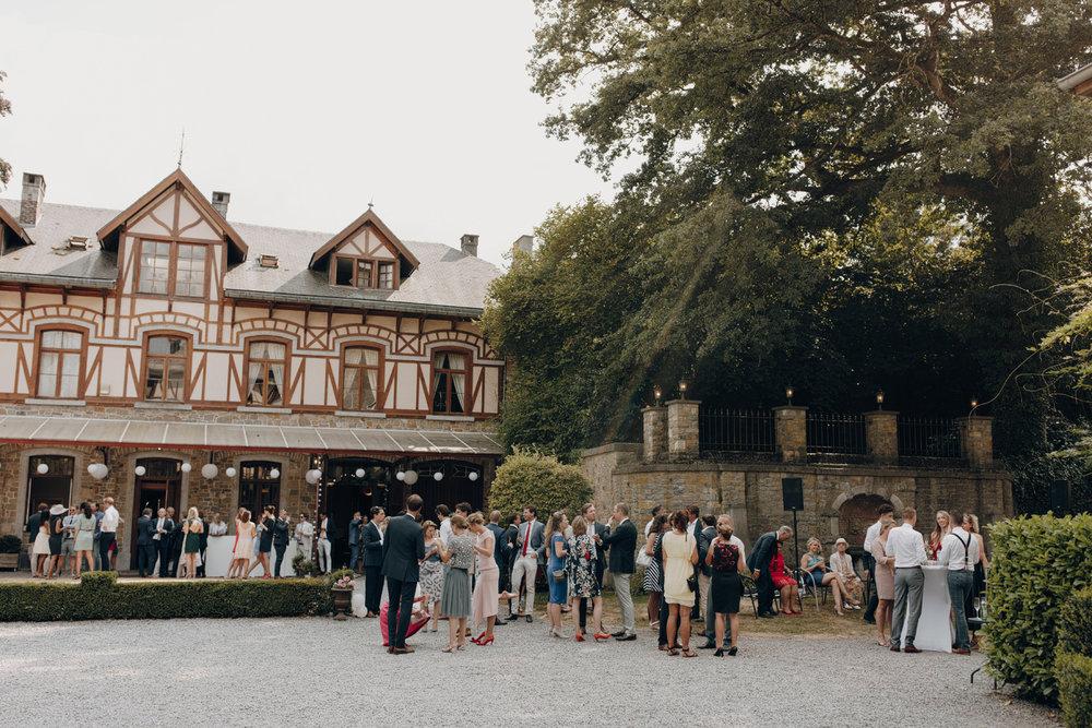 People socializing at Chateau de Presseux