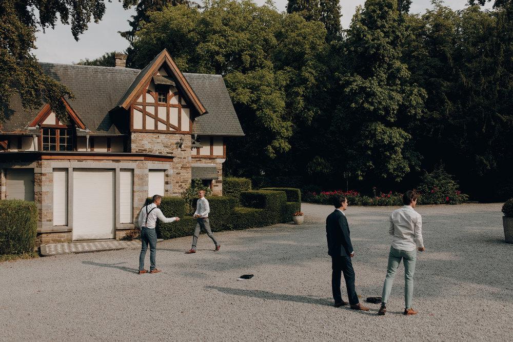 People playing Jeux de boules at Chateau de Presseux