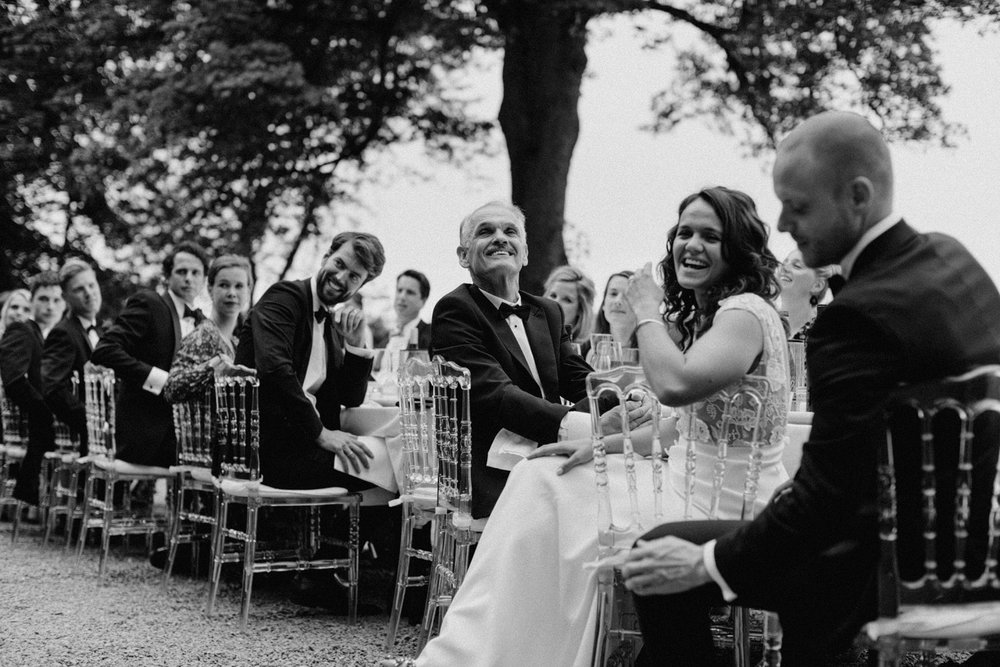Bride laughing during speech at Chateau de Presseux