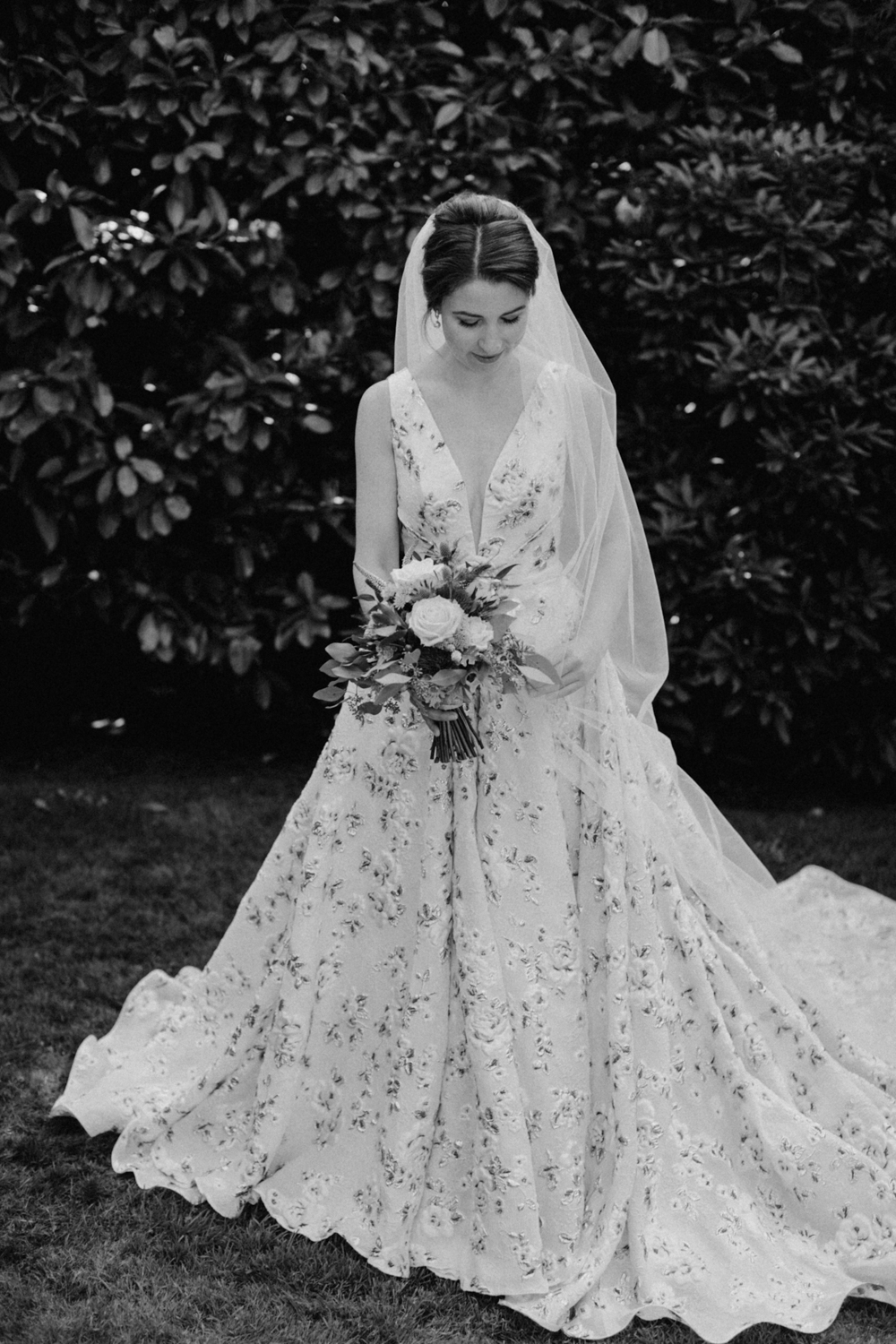 Bride with beautiful dress holding bouquet