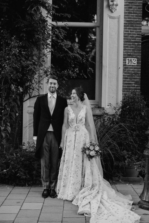 Bride looking at groom smiling at camera