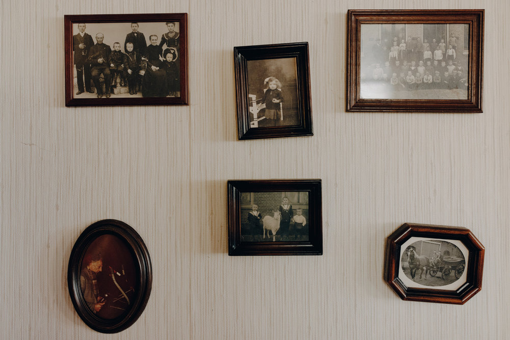 Old family photos hanging on wall
