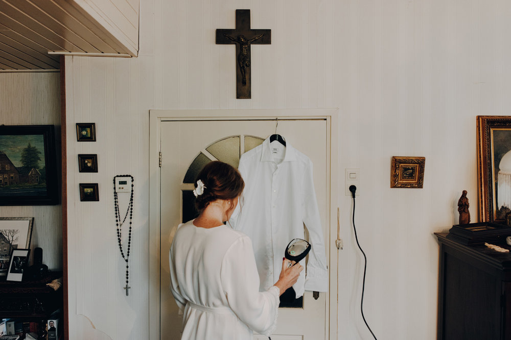 Bride drying her dress