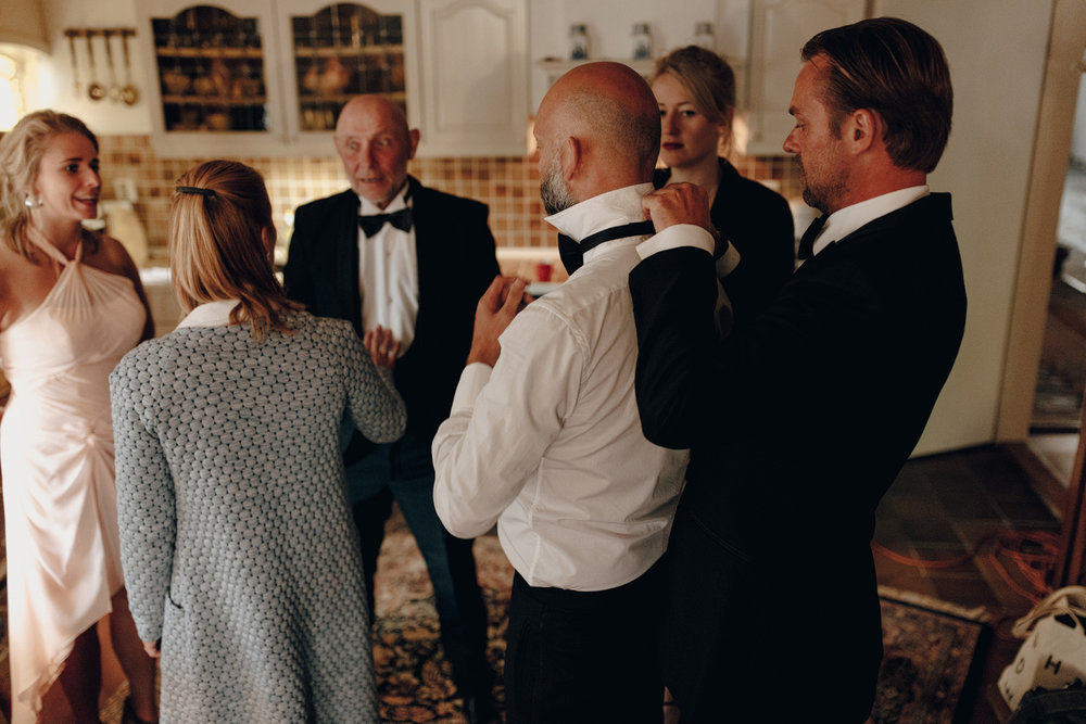 Groom dressing with friends