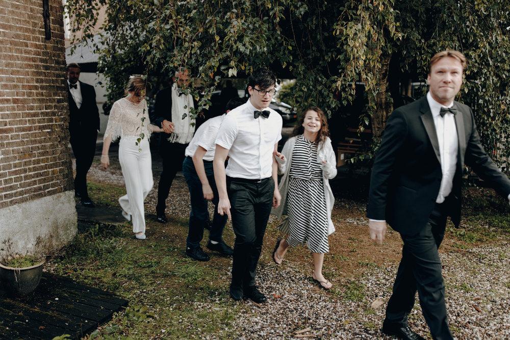 Wedding party walking on farm