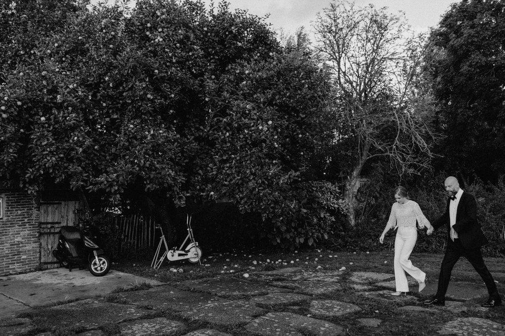 Bride and Groom walking in field