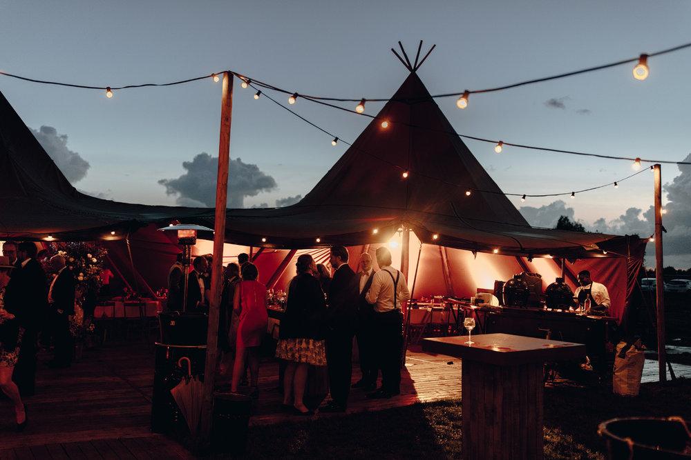 Scandinavian tipi tent and light strings at night