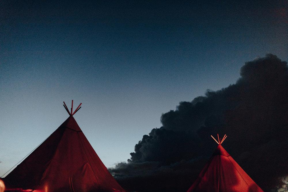 Scandinavian tipi tent at night