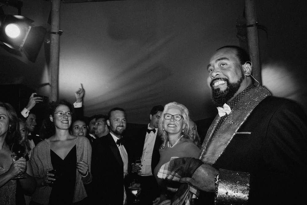 Barry White impersonator smiling at wedding