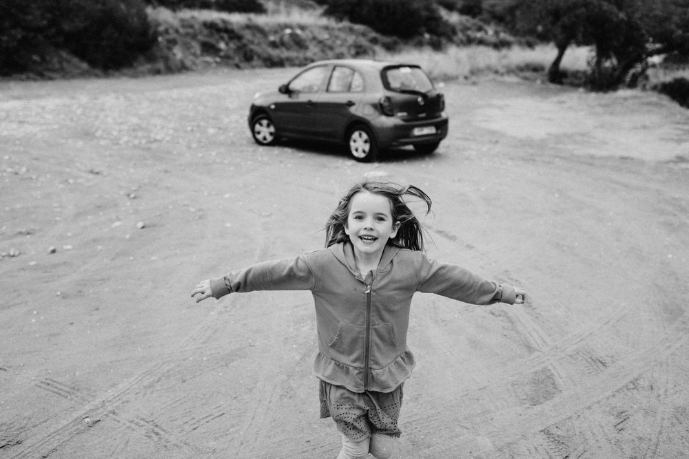 Little girl running with arms wide
