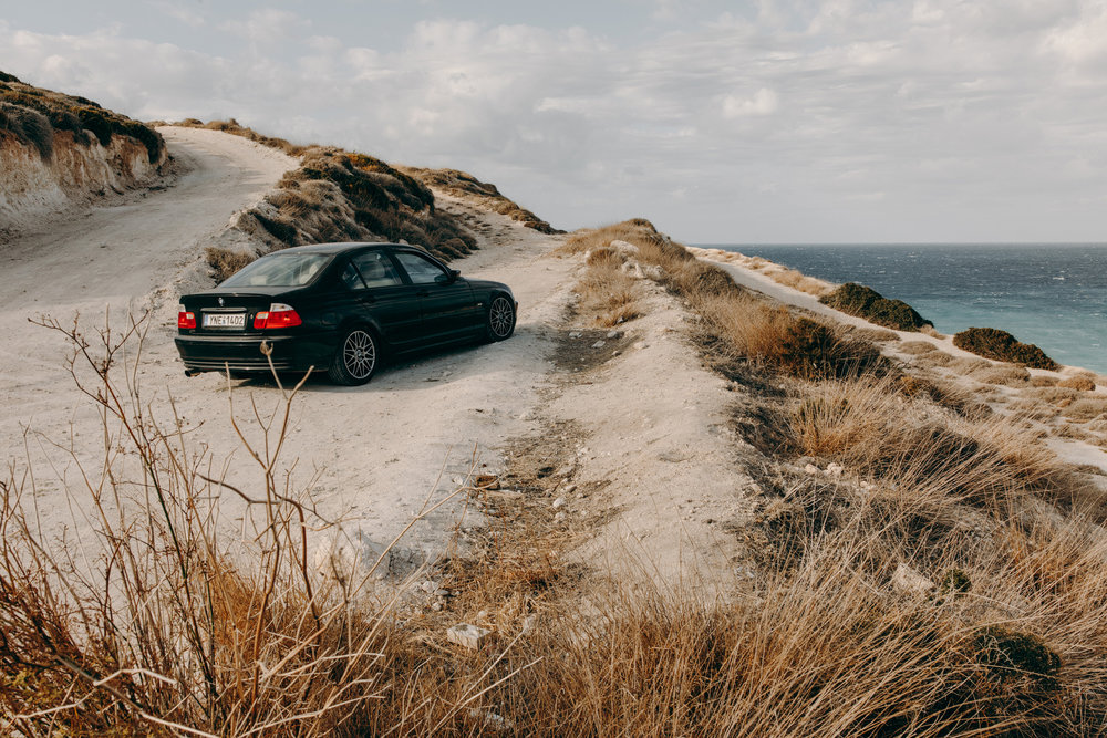 BMW driving on dirt road
