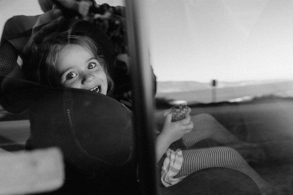 Little girl in car looking out of side window